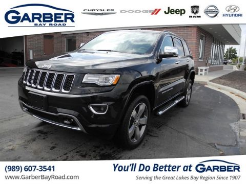 PRE-OWNED 2014 JEEP GRAND CHEROKEE OVERLAND 4WD
