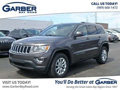 PRE-OWNED 2014 JEEP GRAND CHEROKEE LAREDO 4WD