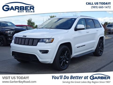 PRE-OWNED 2018 JEEP GRAND CHEROKEE LAREDO 4WD