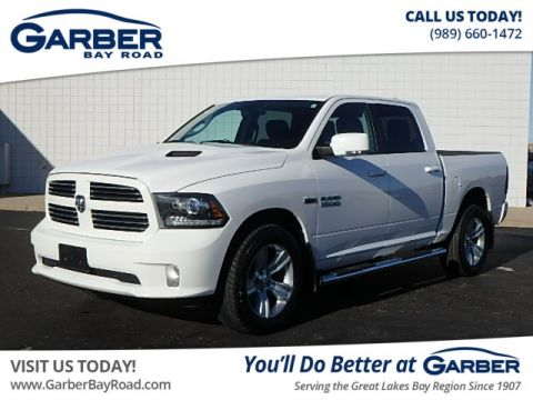 PRE-OWNED 2013 RAM 1500 SPORT 4WD
