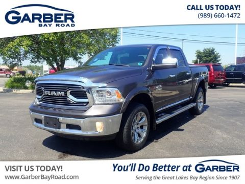 PRE-OWNED 2016 RAM 1500 LARAMIE LONGHORN WITH NAVIGATION & 4WD