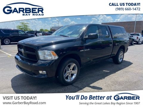 PRE-OWNED 2009 DODGE RAM 1500 SPORT 4WD