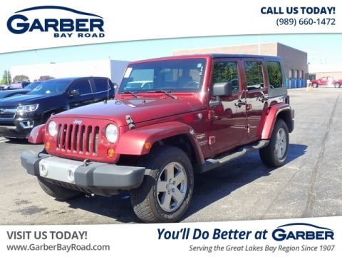 PRE-OWNED 2009 JEEP WRANGLER UNLIMITED SAHARA 4WD